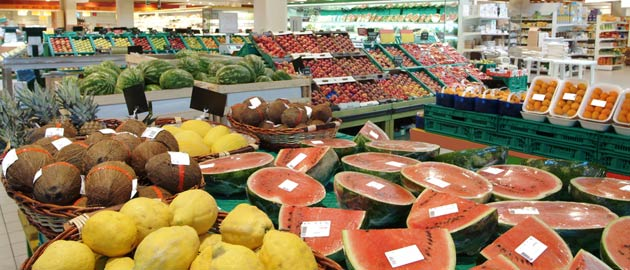 Community Nutrition - wide view of various fruits in a produce section